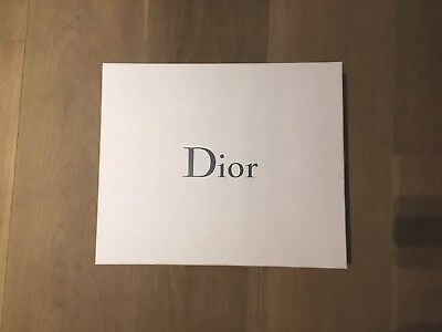 Empty Authentic Dior Gift Box With Tissue Paper and white ribbon inside