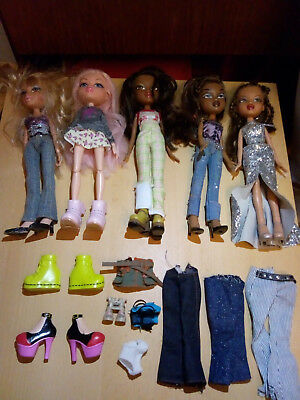 5 Bratz dolls bundle with clothes and extra shoes/accessories