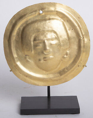 Narino Gold Circular Disc Depicting a Coca Chewer. Colombia, Ca. 1000 to 1300 AD