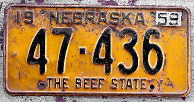1958 Black on Orange Nebraska The Beef State License Plate with a 1959 Tab