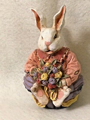 Ornate Resin Bunny Holding Flowers  Baby Aspirin Orange Shirt Brown Pants