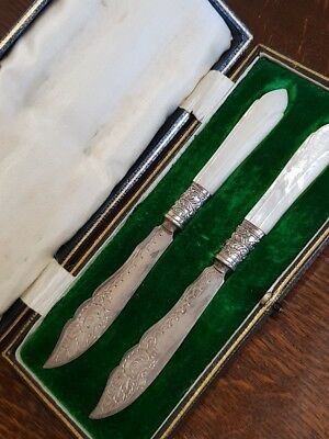 antique boxed pair of mother of pearl handle butter knives