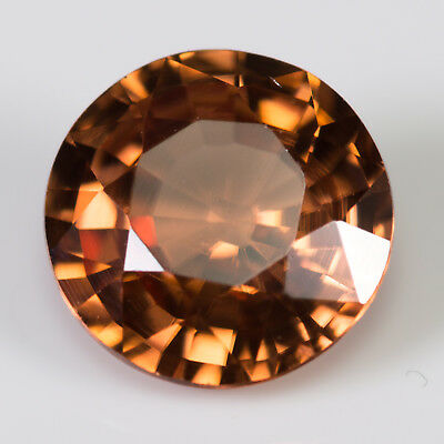 1.37ct Zircon. Round cut, with a champagne / red brown colour. 100% natural gem.