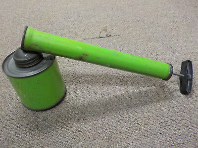 "Vintage Old unbranded bug sprayer duster green, tin canister, about 12"" long"