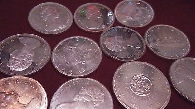1963 - 1966 80% Silver Canadian Dollar   Random Coin out of Picture mostly BU