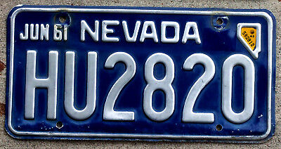 1961 Silver on Blue Nevada License Plate with a Cool Nevada Shaped 1963 Sticker