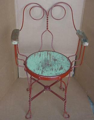 antique ice cream parlor style slant back twisted metal arm chair wrought iron