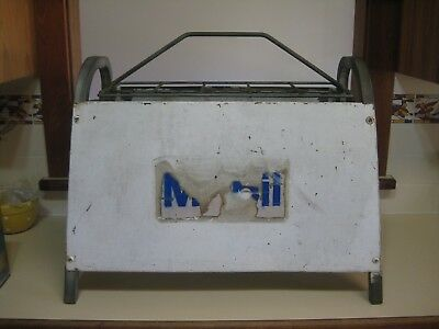 Mobil oil bottle rack non enamel sign.