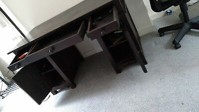 Large fabulous solid dark wood desk. 140cm by 69cm with a height of 79cm .
