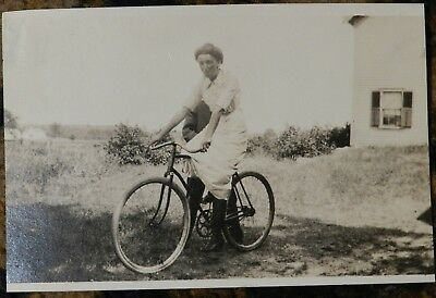 Vtg 1900s 1910s American Life PHOTO Hidden Man Holds Up Poses Woman on Bicycle