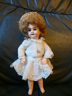 antique 7 inch Cabinet size German Bisque Porcelain Head Doll fully jointed body