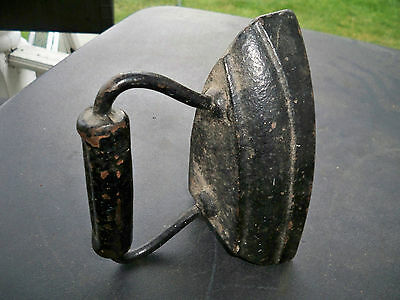 Flat Iron made of cast iron with forged handle weighs 6-7 pounds
