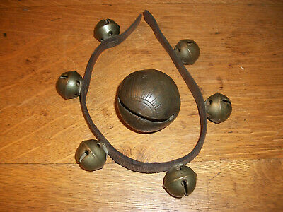 """Antique Lot Of 7 Sleigh Bells Six 1 1/4"""" Bells On Leather Strap One 2 1/2"""" Bell"""