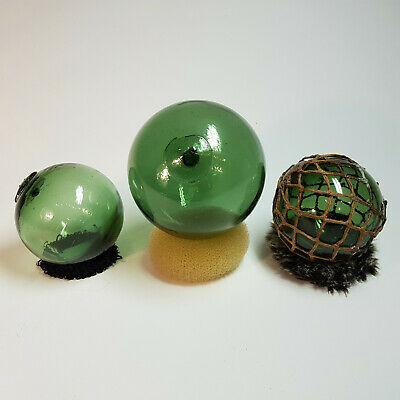 Antique glass fishing floats from Norway marked F, M, and L