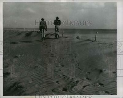 1956 Press Photo Two farmers inspect land near Kit Carson in eastern Colorado