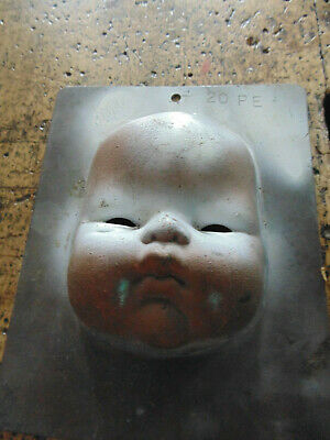 Industrial Baby Doll Head Paint Mold Creepy