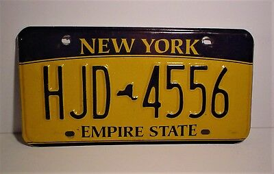 New York License Plate  HJD-4556 Embossed Empire State 2010 Base Date