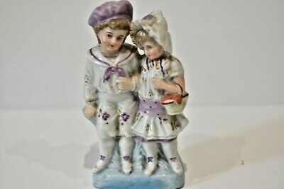 Late 19th century Porcelain Figure of a Boy & Girl