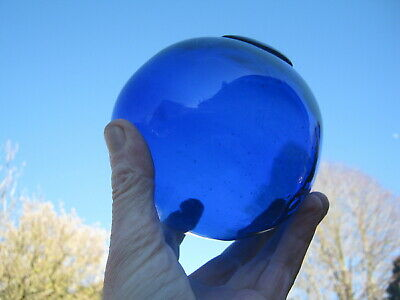 Stunning cobalt blue freeblown glass antique fishing float with applied seal.