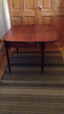 Antique mahogany tea-table D-shape, on tapered legs with brass castors, 1830's
