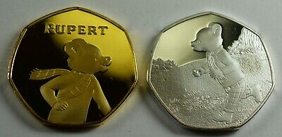 Pair of RUPERT THE BEAR Silver/Gold Commemorative Coins Albums/50p Collectors.