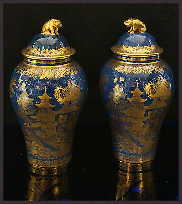 A Pair Of English Spode Powder Blue & Gilt Chinoiserie Decorated Lidded Vases.