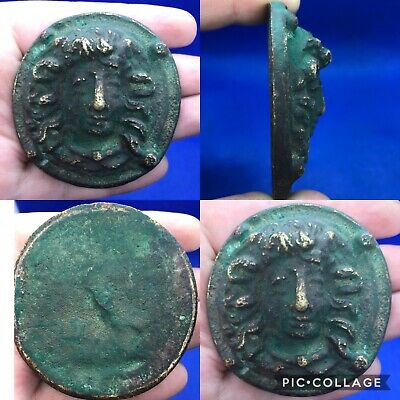 wonderful rare ancient Roman bronze face amulet