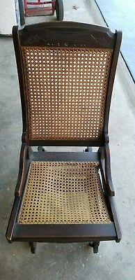 Antique Glider Chair with wooden wheels Possibly Murphy Chair Co
