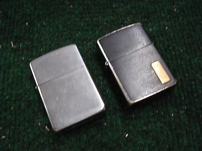 VINTAGE ZIPPO LIGHTERs , one black monogram, one brushed staiinless