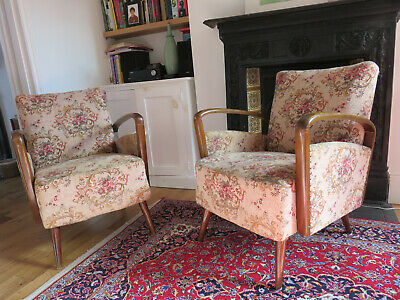 A pair of original vintage mid centaury armchairs
