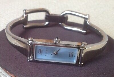 4bf1c875831 GUCCI 1500 Bangle Women Swiss Made Stainless Steel Blue Dial Watch YA015535
