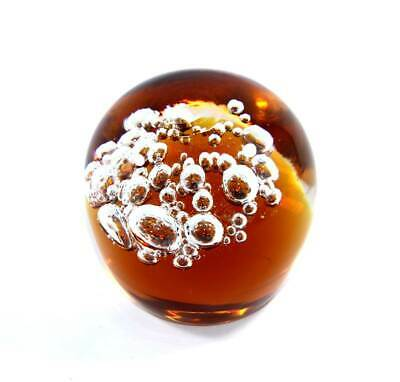 Vintage solid glass amber controlled bubble paperweight
