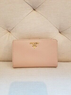 0de52c5239f4 Pre-Owned Prada's Women Wallet w/proof of purchase and authenticity card.