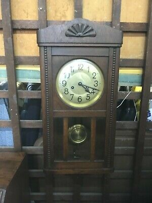 Antique oak cased wall clock fully working