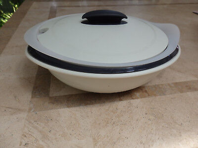 .Tupperware 4 piece Serving Container. Beige Base & Lid.. Black Insert Dish