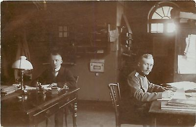 Military Officer In A Office~Stamper~Bookwork~Lamp~RPPC European?  c1914 WWI
