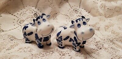 Cows Blue and White  salt and pepper shakers EUC used as display only.