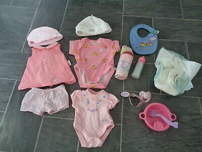 baby born bundle-clothes,hats,bib,bottle+pouch,nappy,dummy with clip+bowl/fork