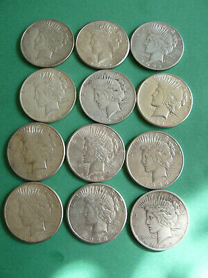 (12) Raw VF-AU Peace Silver Dollars, 1922,1923, (8) with mint marks