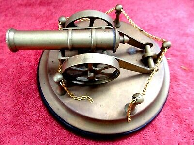 VINTAGE  BRASS  CANNON  MOUNTED  ON  BRASS & WOOD  DISPLAY STAND   17cm.