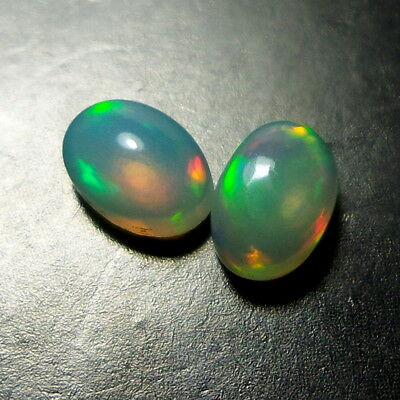 0.9 Ct TOP NATURAL ETHIOPIAN MULTI FIRE OPAL 6X4 MM OVAL SHAPE CABOCHON PAIR !!