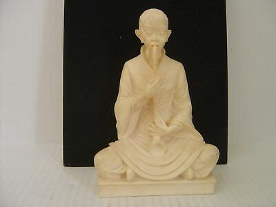 Vintage Ivory Colored Chinese Man Sitting And Blowing A Horn Figurine