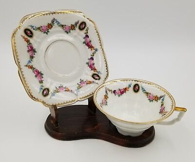 VINTAGE PORCELAIN TEA CUP & SAUCER BY BAYER OSTMARK WHITE W/ FLOWERS & GOLD TOPb