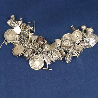 Vintage Sterling Silver Charm Bracelet 53 Charms Total weight 216 grams / 7.6 oz