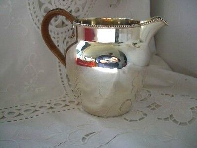 Silver Plate Jug  With a Rattan Handle