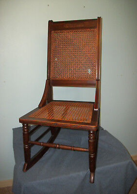 VINTAGE EARLY AMERICAN WALNUT ARM LESS ROCKING CHAIR - CANED SEAT & BACK ca.1920