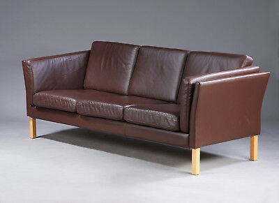 Danish vintage tree seater sofa upholstered in brown patinated leather