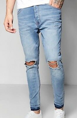 03f5cfeabfa2 Boohoo MAN Skinny Fit Jeans with Distressed Knee and Hem Pale Blue Size 36  NWT