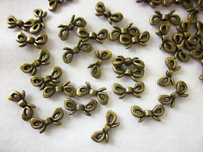 25 Antique Bronze Coloured Ribbon Bow Spacer Beads 12mmx6mm #sp1821 Findings