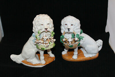 A Stunning Pair of Vintage German Poodle Type Dogs with Baskets